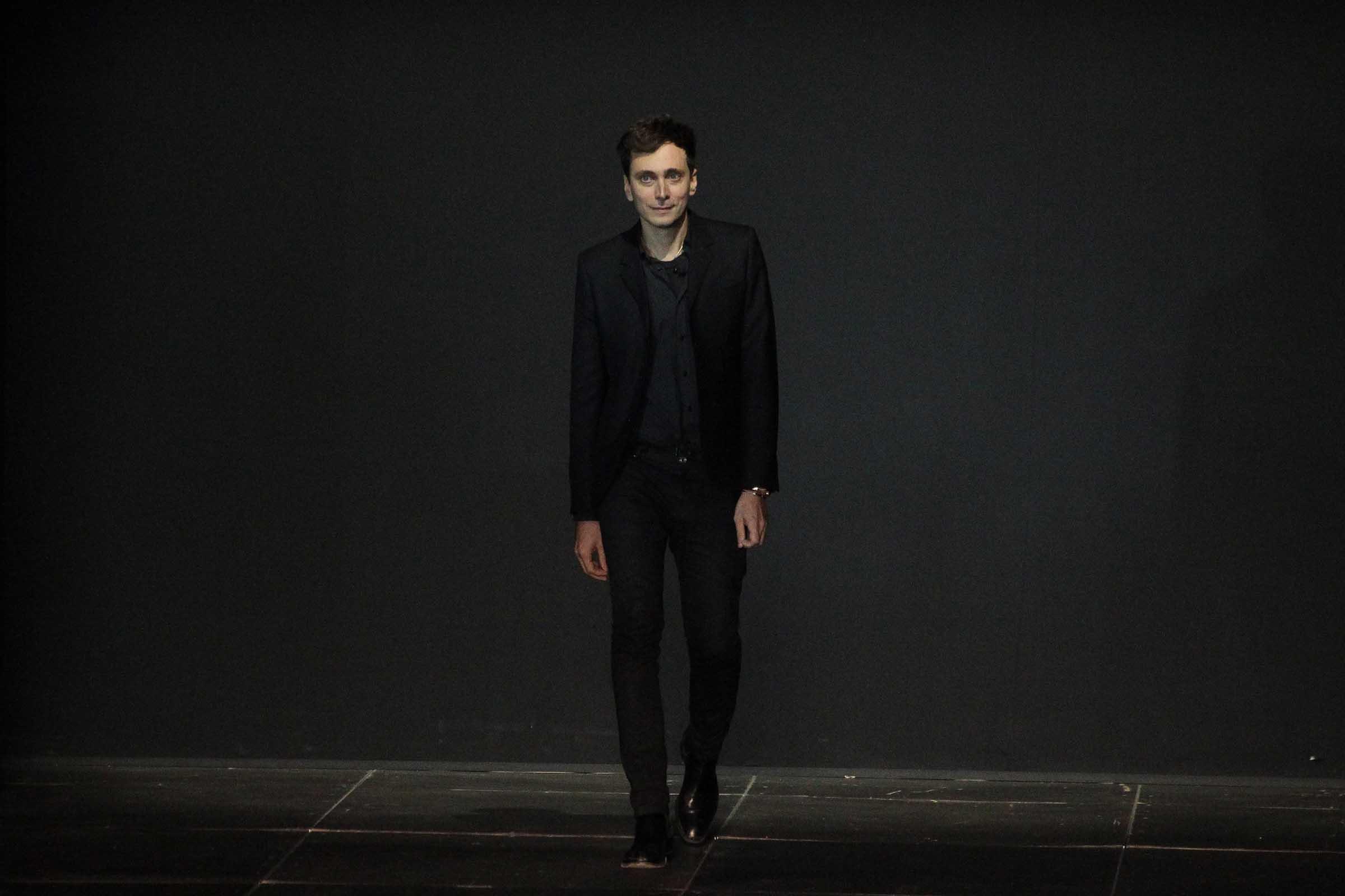 The all-world designer Hedi Slimane in his signature black suit