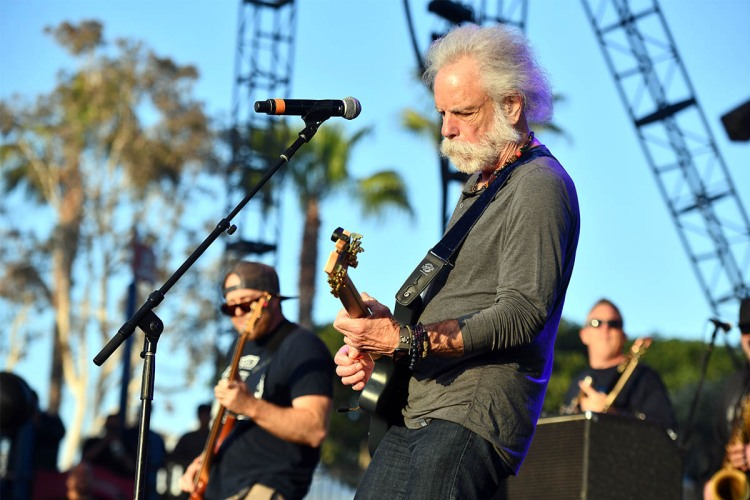 Bob Weir plays a guitar solo in 2019. The guitarist does a rather extensive pre-concert workout to stay in shape.