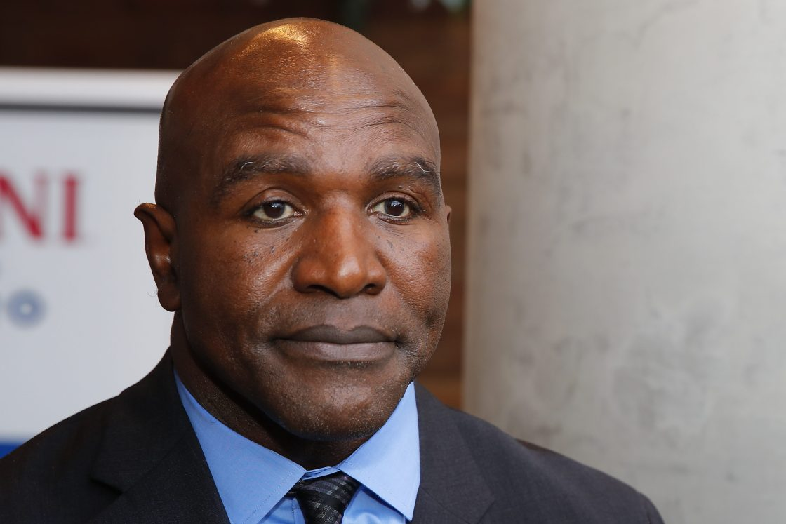 Evander Holyfield addresses the media after his statue unveiling in Atlanta.