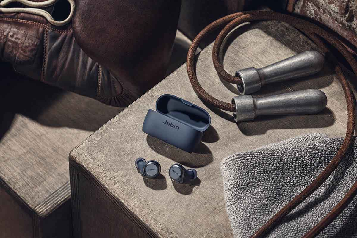 The Jabra Elite Active 75T earbuds, now on sale, next to a jump rope and other workout gear -- we rated the earbuds ideal for those with an active lifestyle.