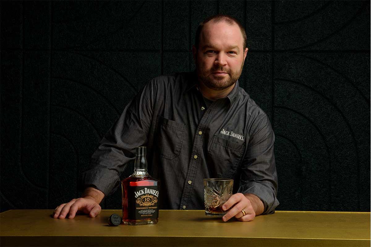 Master Distiller Chris Fletcher and a bottle of Jack Daniel's 10-Year Old Tennessee Whiskey