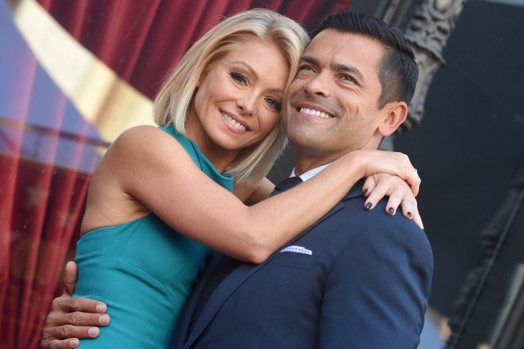 Kelly Ripa and Mark Consuelos embrace in a photo taken at a 2015 event honoring Ripa's star on the Hollywood Walk of Fame
