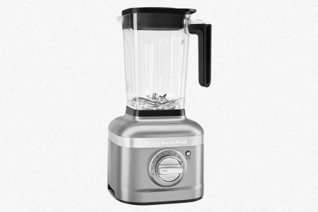 The KitchenAid K400 Variable Speed Blender in silver on a grey background