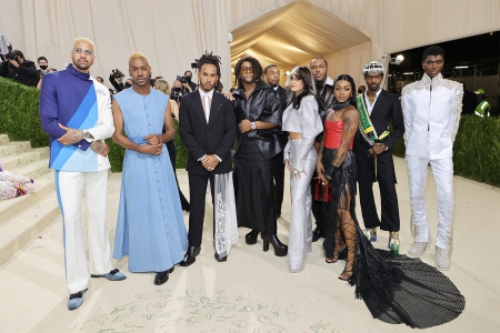Lewis Hamilton, third from left in a black suit with white lace, and those he invited to the 2021 Met Gala, including Black fashion designers, creatives and athletes