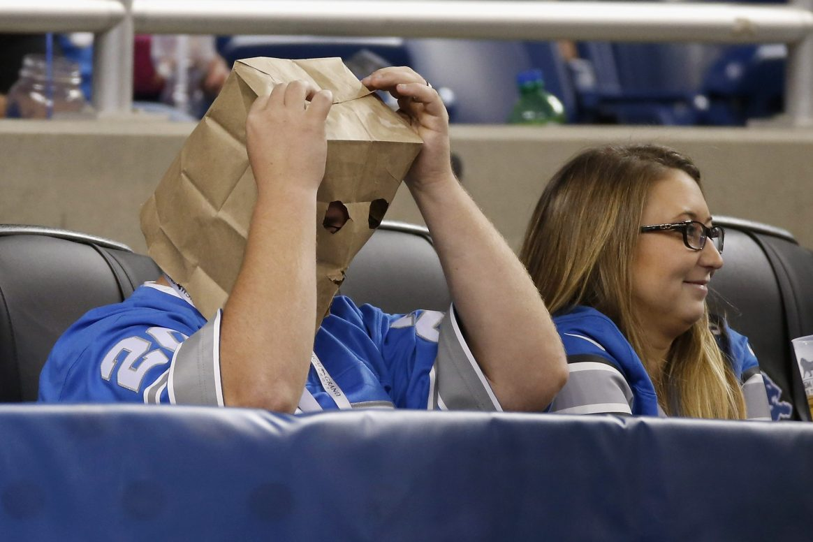 A Detroit Lions fan looks on with a paper bag on his head during a 2015 game