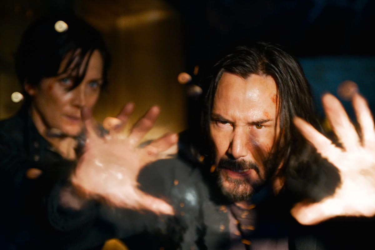 """Carrie-Anne Moss and Keanu Reeves in a scene from """"The Matrix Resurrections."""" The trailer for the sequel just launched."""