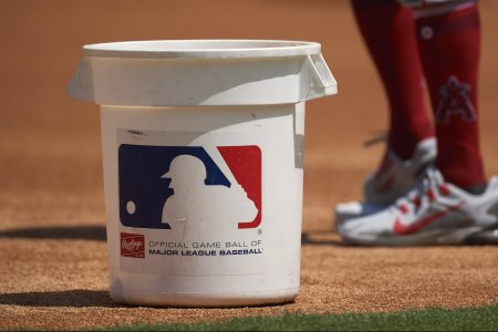 A bucket with the MLB logo on it on the field before a game