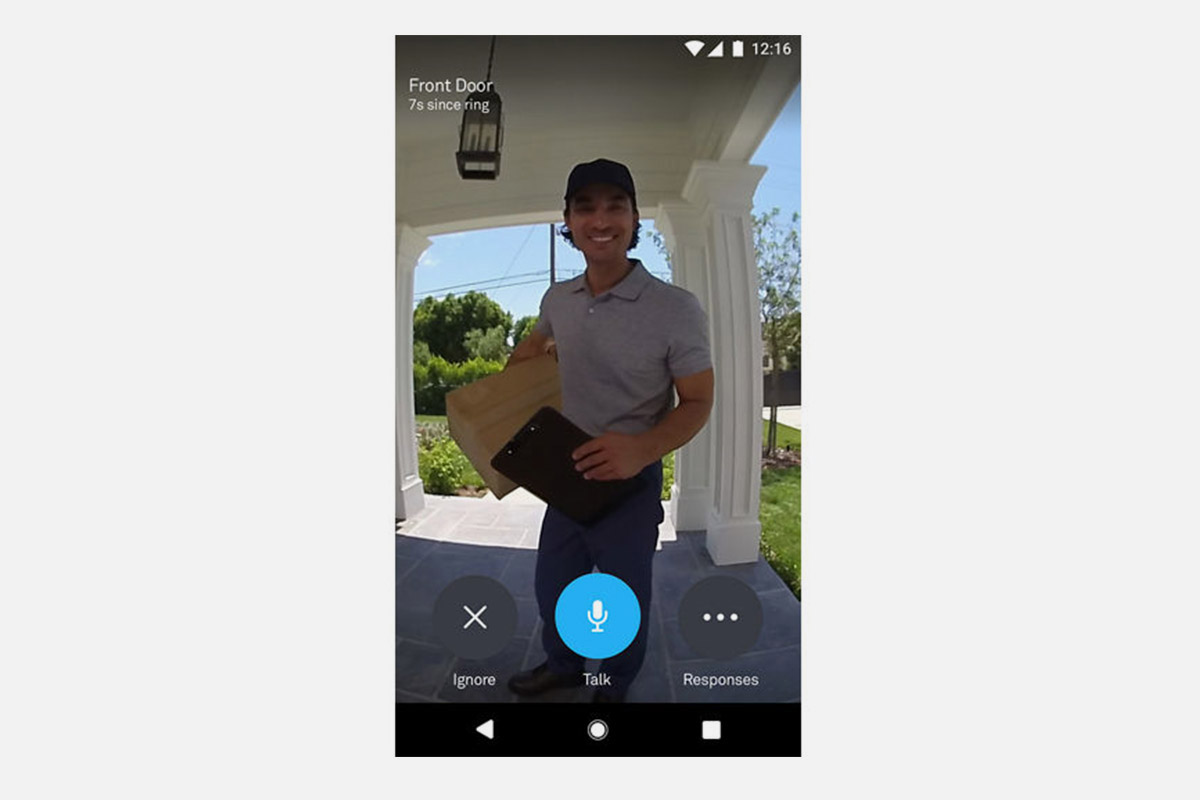 a sample video image taken from the Google Nest Hello video doorbell, showing a man delivering packages and standing on a porch