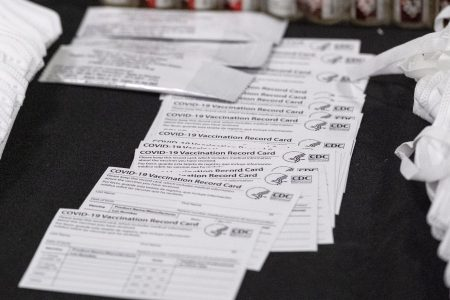U.S. Customs and Border Protection puts seized counterfeit Covid-19 vaccination cards on display.
