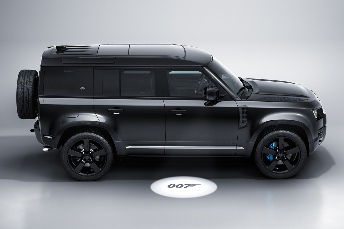 """A side view of the all-black, limited-edition James Bond Land Rover Defender V8 inspired by """"No Time to Die"""" and featuring 007 puddle lamps"""