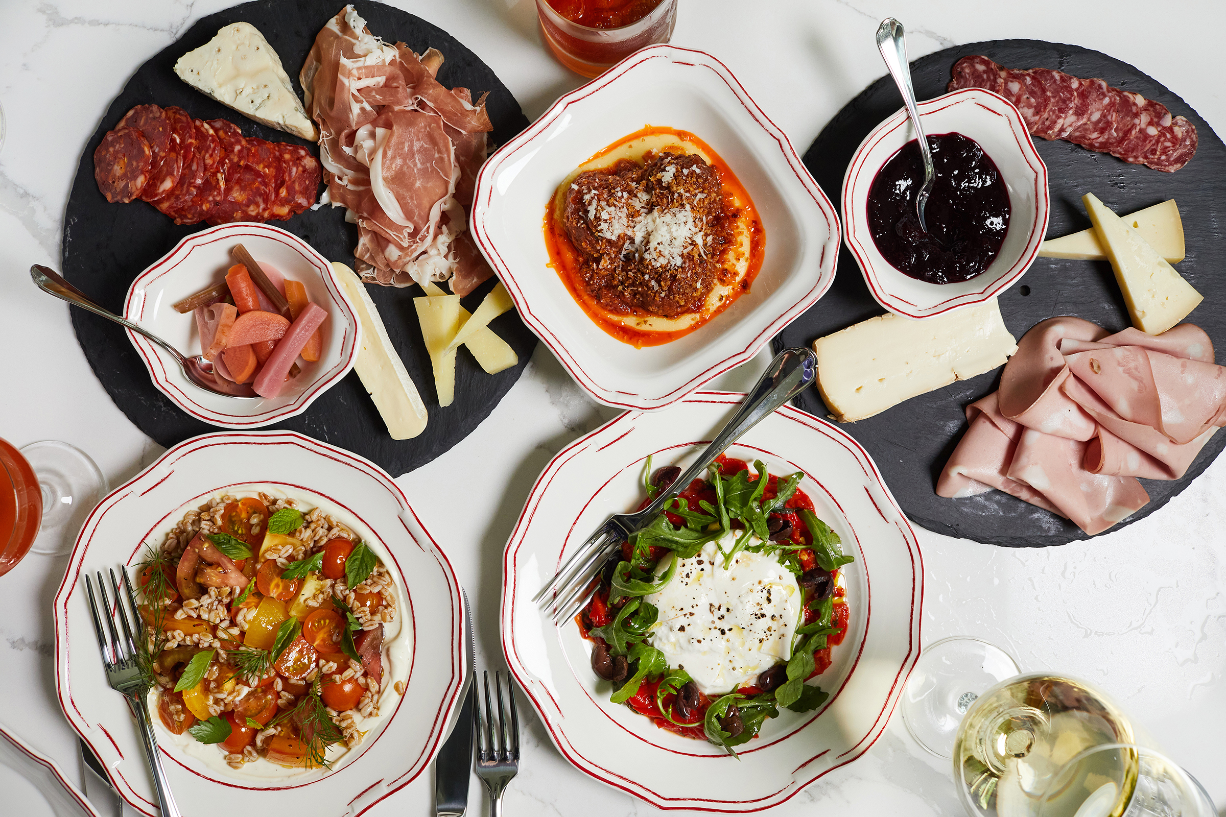 A spread of salads and antipasti at Officina