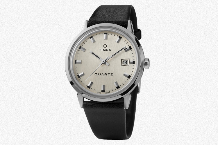 The new Q Timex 1978 Reissue quartz watch with a black leather strap on a grey background