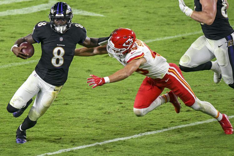 Baltimore Ravens quarterback Lamar Jackson avoids a tackle against the Kansas City Chiefs