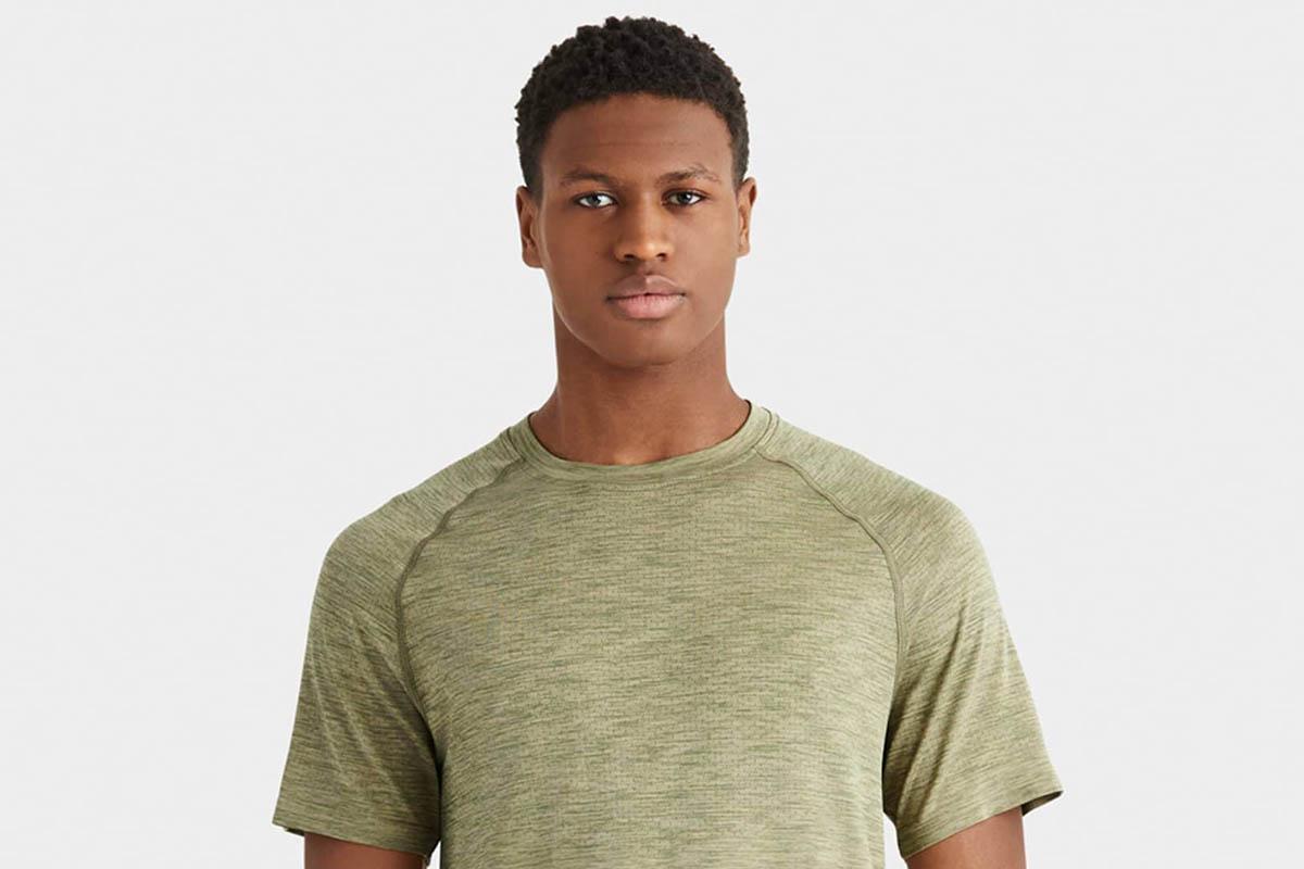 man in a green Reign Tech Shirt from Rhone, now 25% off