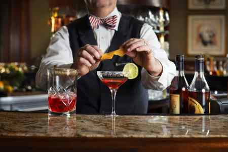 A bartender makes a cocktail at The Round Robin Bar at the Willard Intercontinental