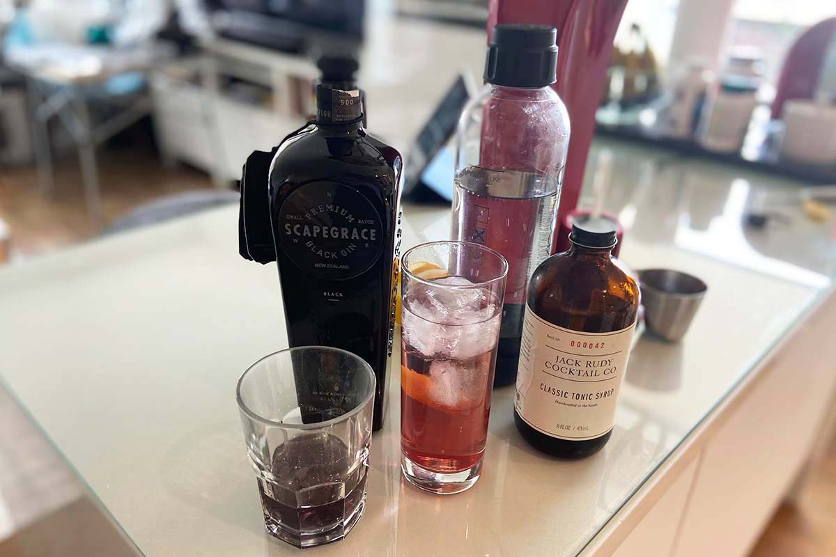 Scapegrace Black Gin on its own and in a G&T