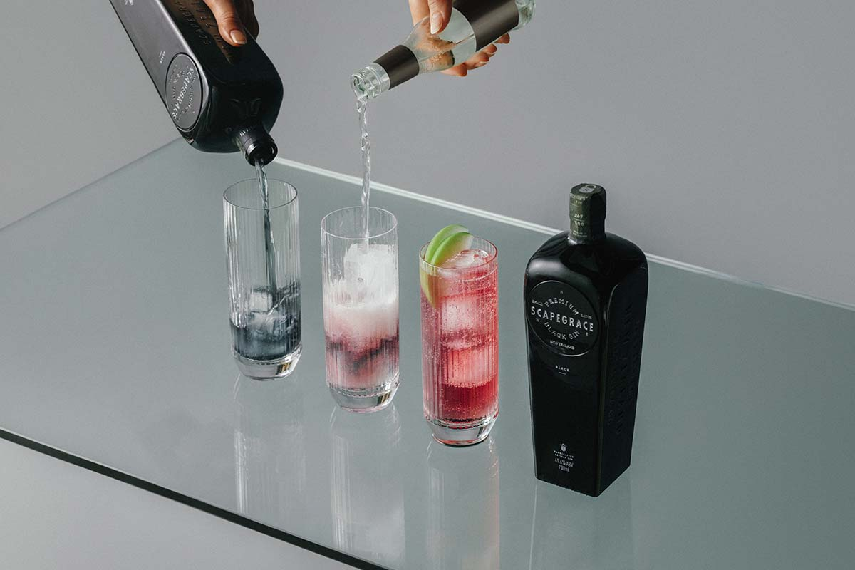 Scapegrace Black Gin, poured neat and in a cocktail, where it changes color