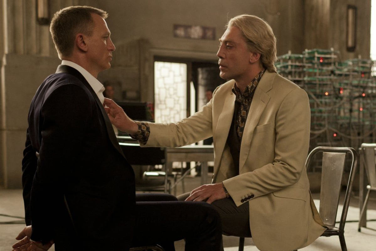 """Javier Bardem as villain Raoul Silva in the movie """"Skyfall"""" touching Daniel Craig (who played James Bond) on the chest"""