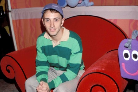 """Steve Burns during 1999 """"Kids for Kids"""" Carnival Elizabeth Glasser Pediatric Aids Foundation Fundraiser. Steve sits on the iconic Blue's Clue red chair in his equally iconic green striped sweater."""