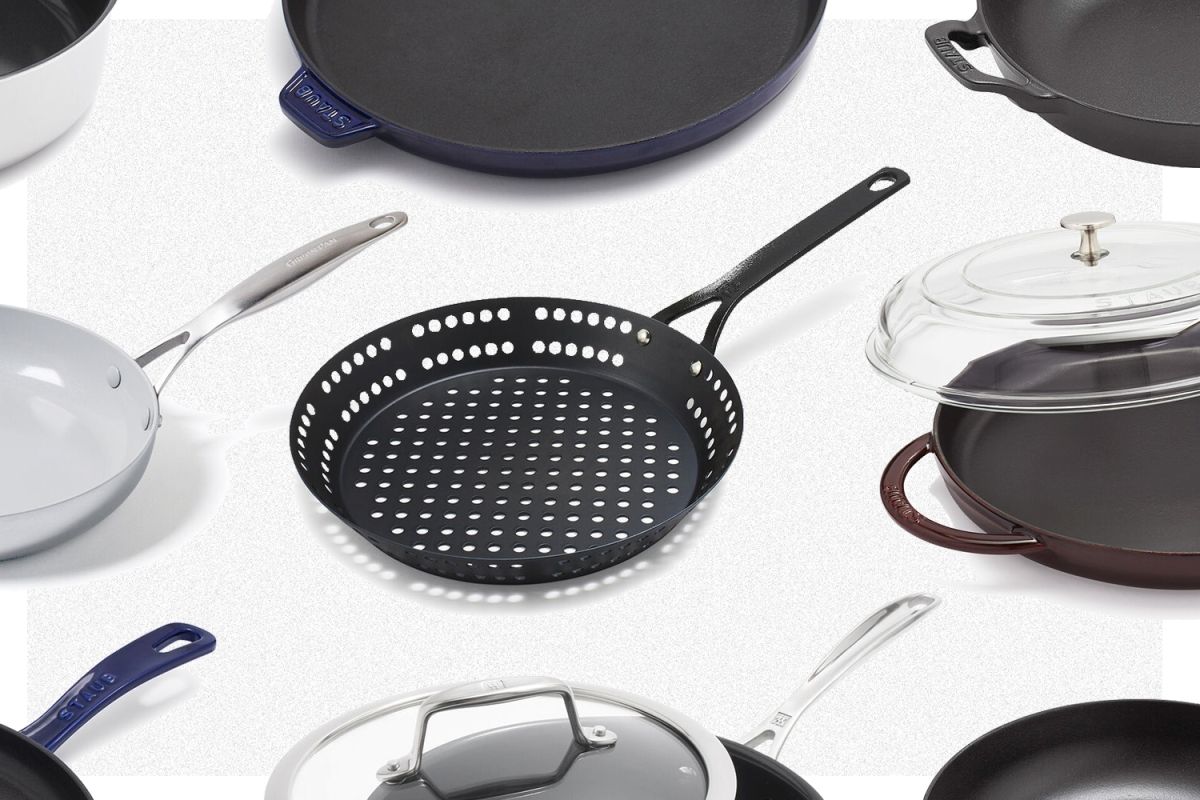 Nine different skillets from Sur La Table's Warehouse Sale on a grey background, including a carbon steel grill skillet, Staub griddle pan and ceramic nonstick skillet