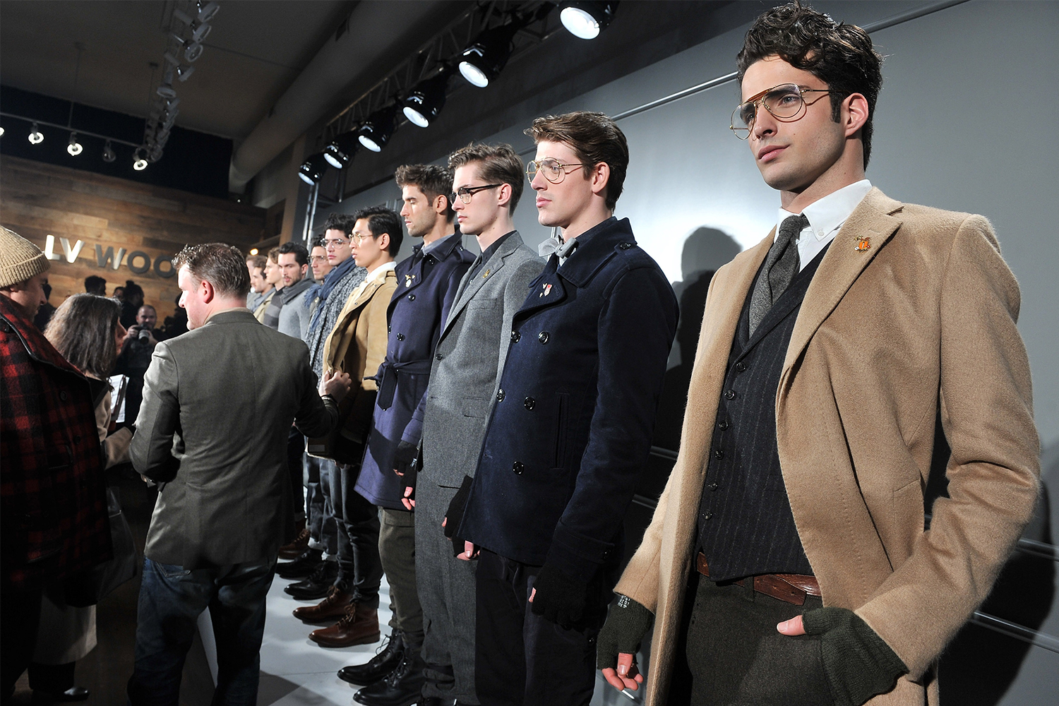 A line of models wearing clothes designed by menswear designer Todd Snyder in his fall 2012 New York Fashion Week show at LV Wood