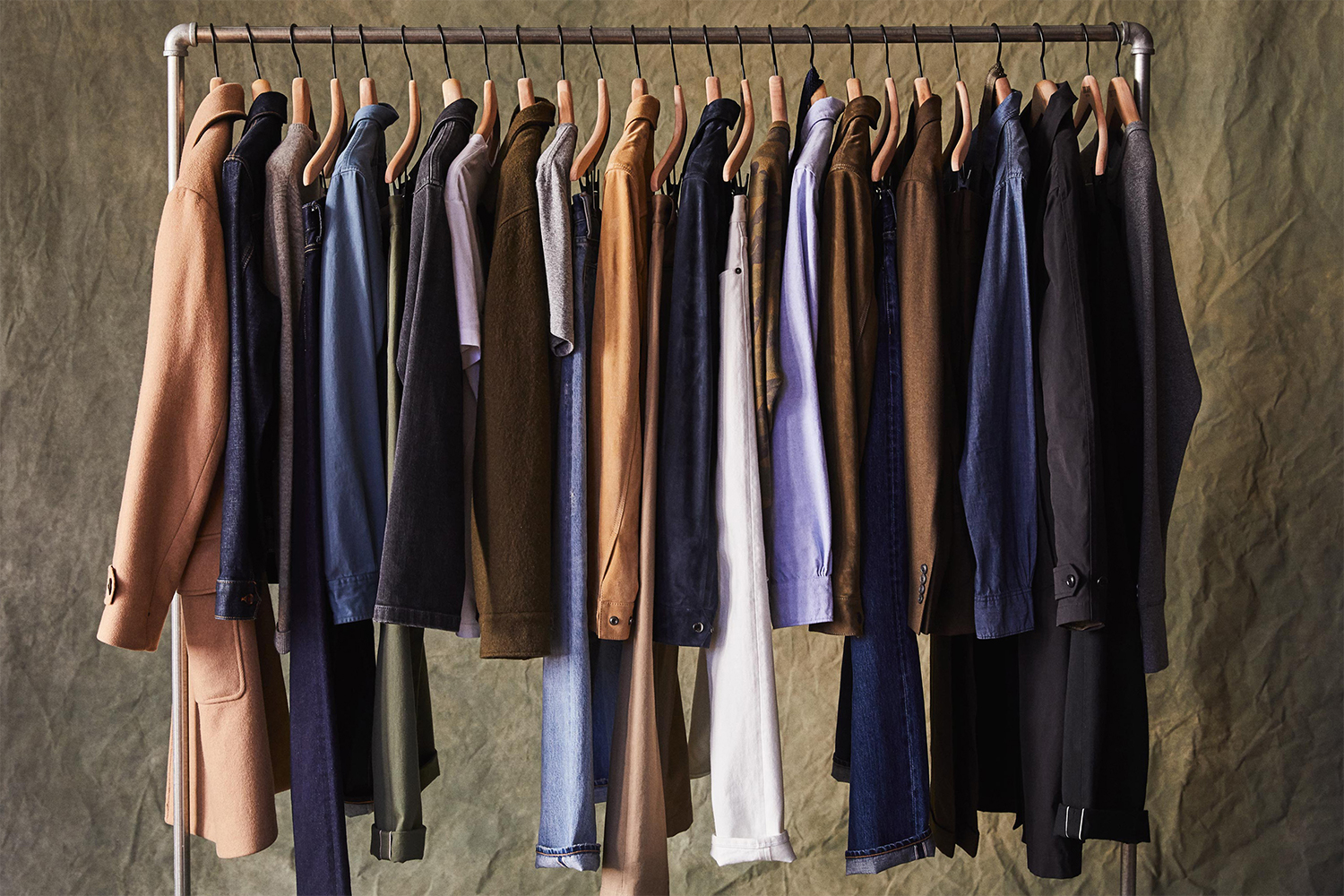 A rack of men's clothes, from pants to shirts to jackets, from Todd Snyder's TSX capsule collection, a 10-year anniversary clothing line