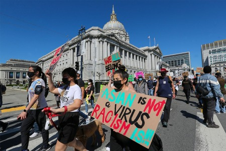 A group of people in San Francisco protesting hate crimes against Asian Americans.