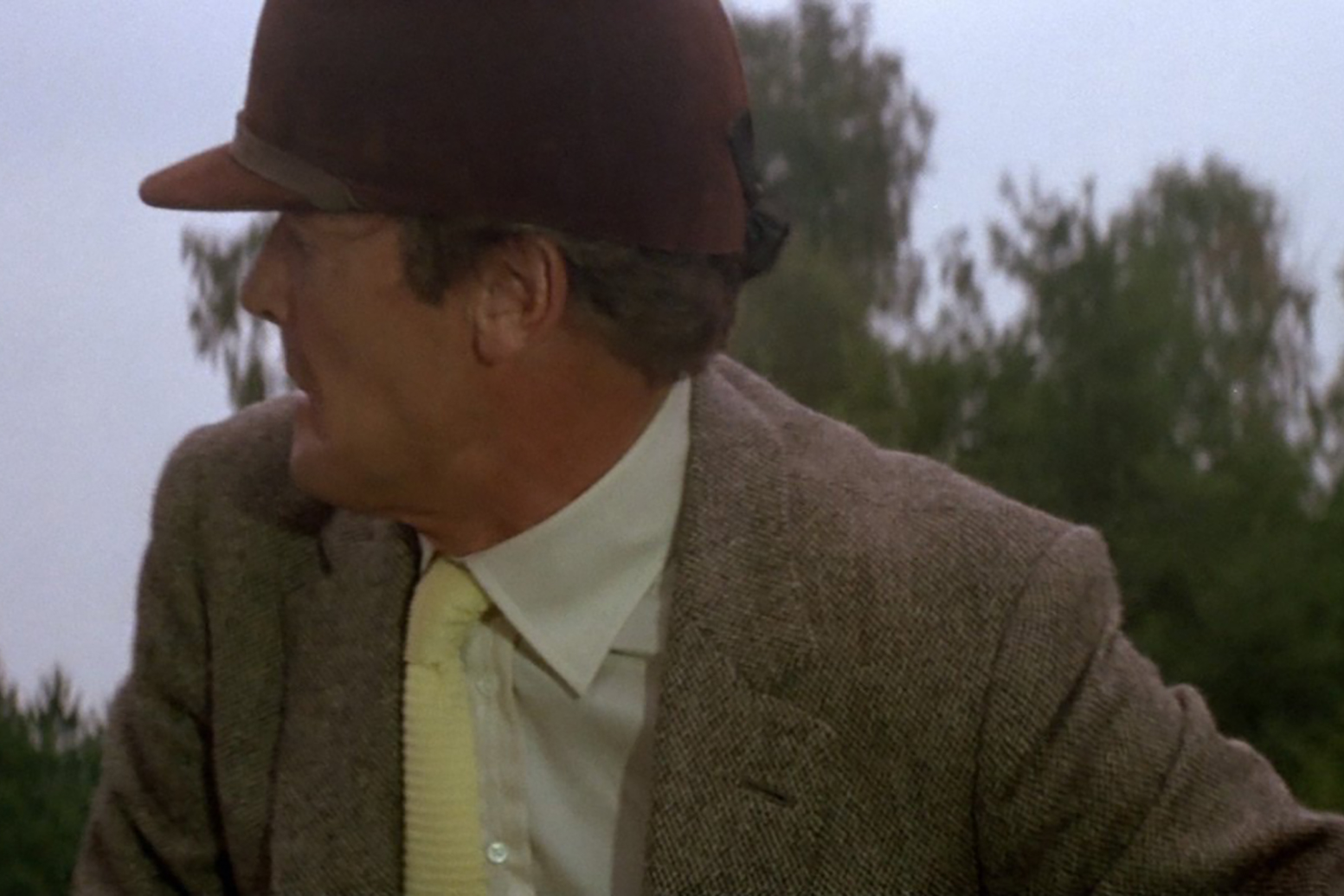 Roger Moore wears a distinctly English riding getup in A View to Kill.