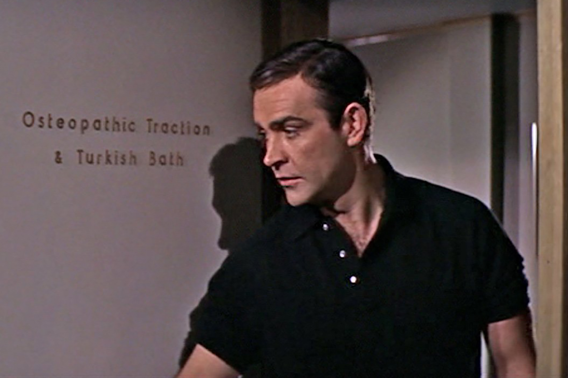 In Thunderball, Connery wears a long sleeve polo with the sleeves rolled up.