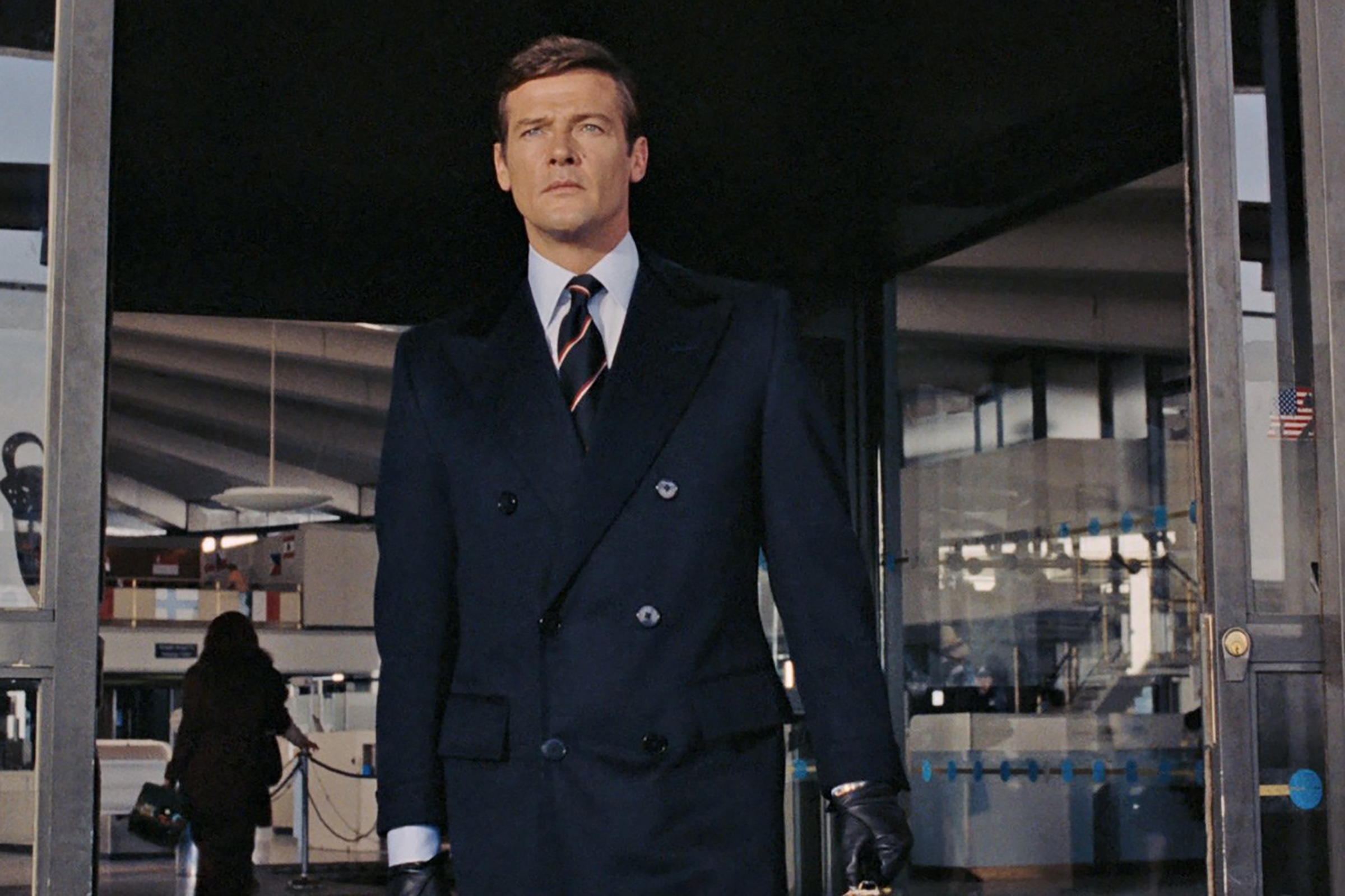 Roger Moore wears a beautiful double breasted jacket in Live and Let Die.