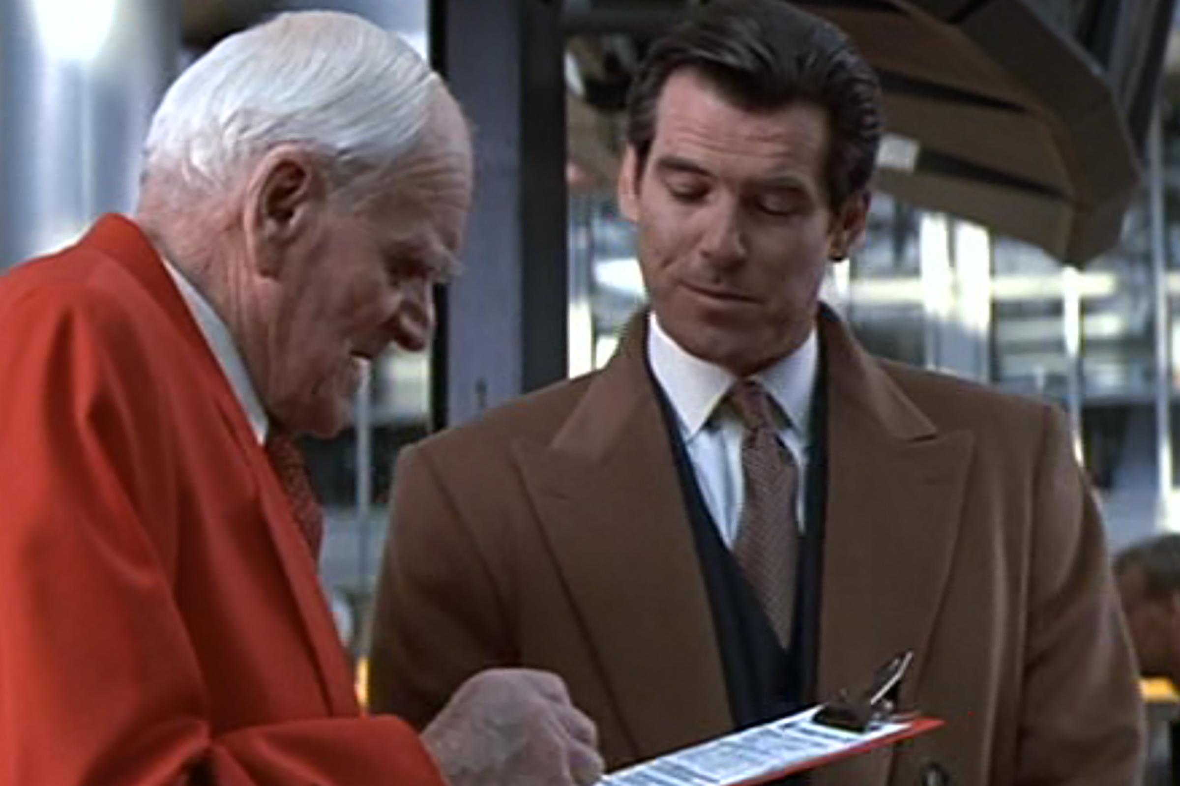 Brosnan wears a pristine Brioni navy suit in Tomorrow Never Dies.