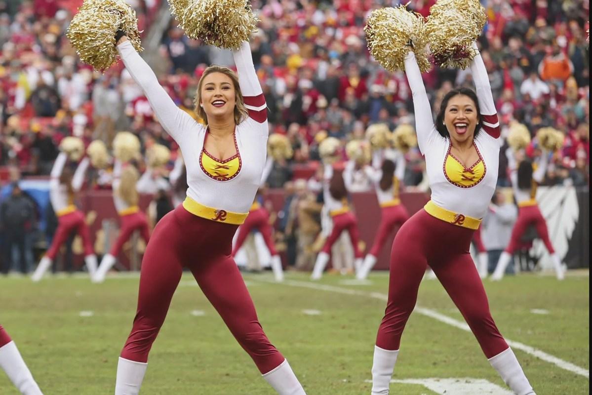 Washington Football Team's dancers cheer at a game.