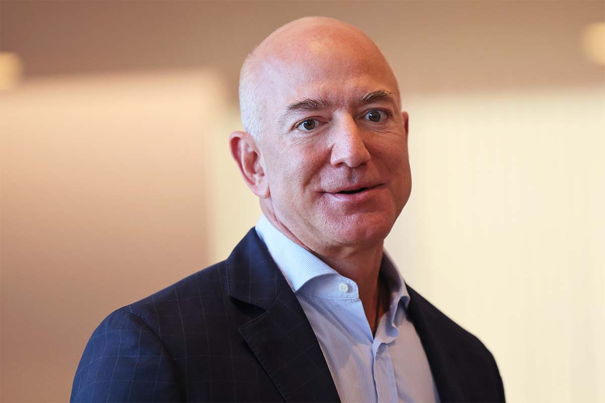 Jeff Bezos, who just topped the Forbes 400 list of wealthiest Americans, in a blazer and unbuttoned shirt