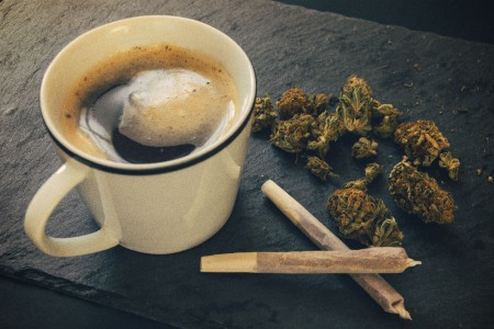 A cup of coffee, two joints and some loose cannabis. Weed and caffeine can work well together, according to some experts