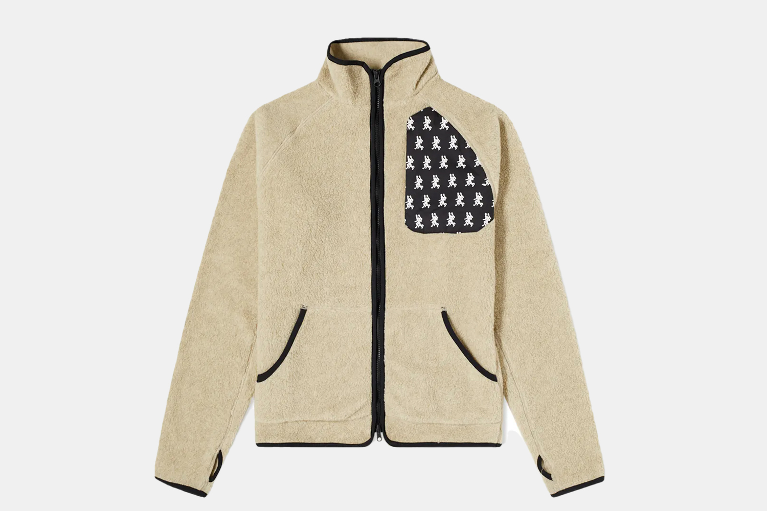 a cream fleece with a patterned pocket.