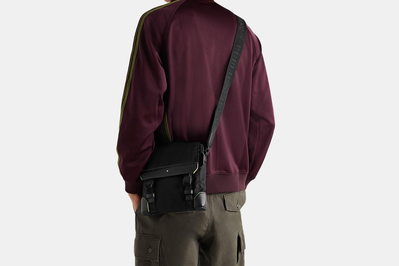 a model wearing a black bag