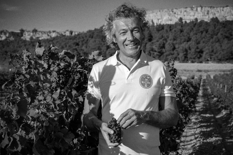 Gérard Bertrand patrols one of his vineyards