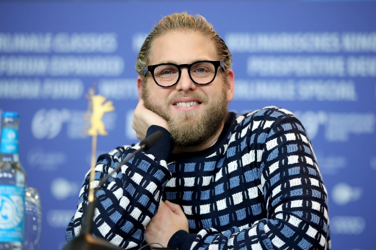 """Actor Jonah Hill wearing glasses and a sweater during a press conference for his movie """"Mid90s"""""""