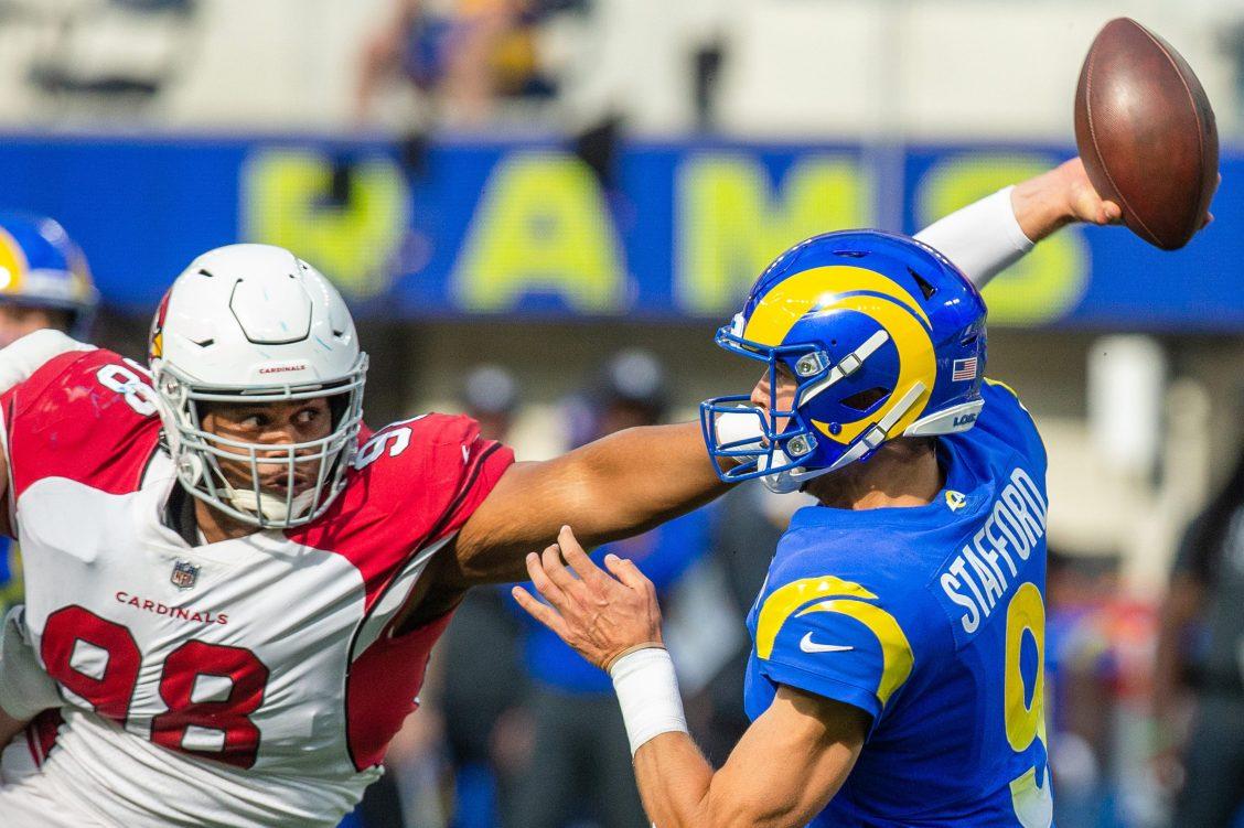 Arizona Cardinals defensive tackle Corey Peters pressures Rams quarterback Matthew Stafford