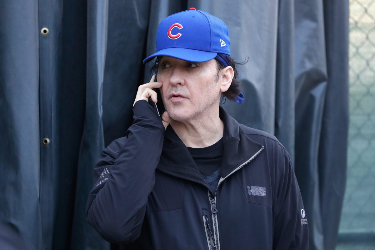 John Cusack stands outside Wrigley Field in Game Three of the 2016 World Series between the Chicago Cubs and the Cleveland Indians at Wrigley Field on October 28, 2016 in Chicago, Illinois. A member of Barstool Sports recently tried to confront the actor about his dual Cubs/White Sox fandom