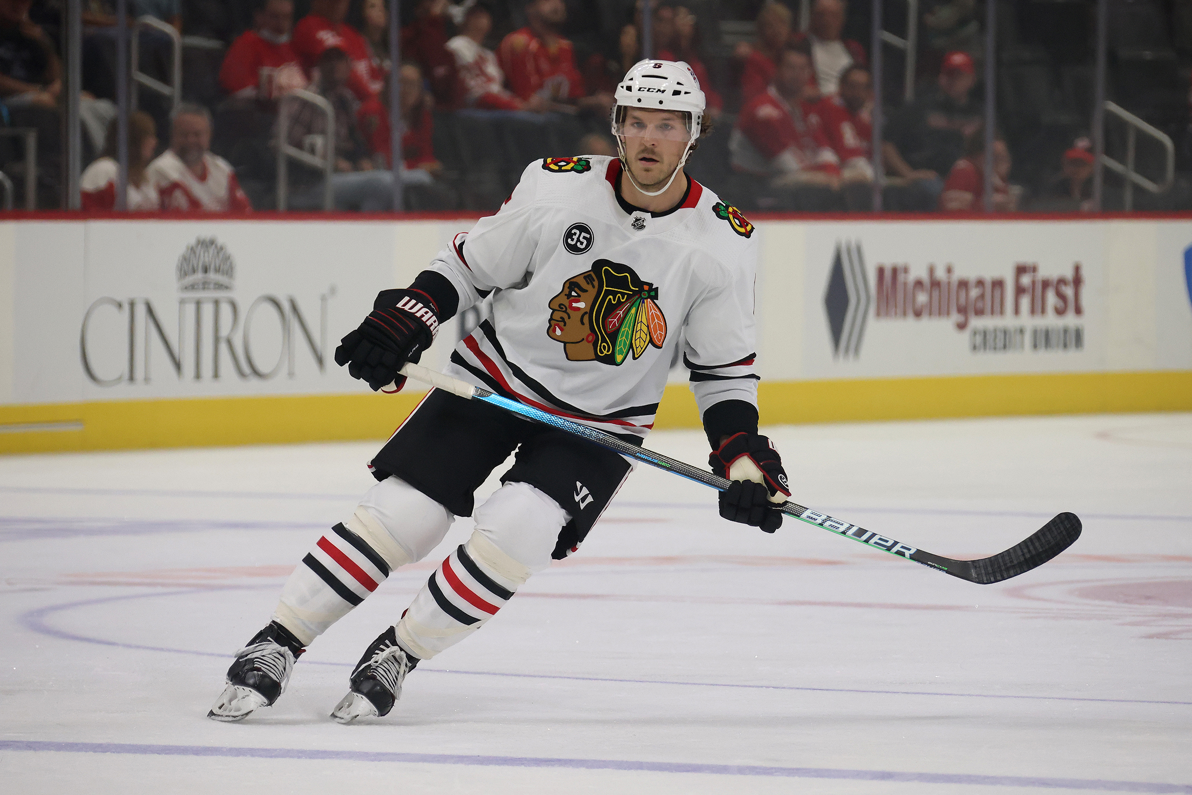 Jake McCabe #6 of the Chicago Blackhawks skates against the Detroit Red Wings during a preseason game at Little Caesars Arena on October 04, 2021 in Detroit, Michigan