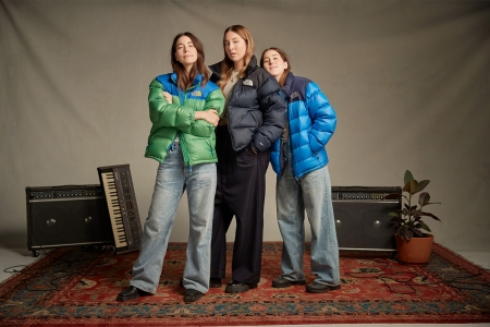 a picture of the band HAIM in The North Face Jackets