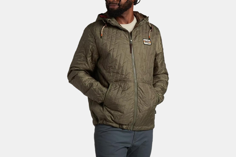 a green zip up puffer jacket