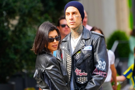 Travis Barker and Kourtney Kardashian embrace on the street in New York. Barker proposed to Kardashian with an oval engagement ring.