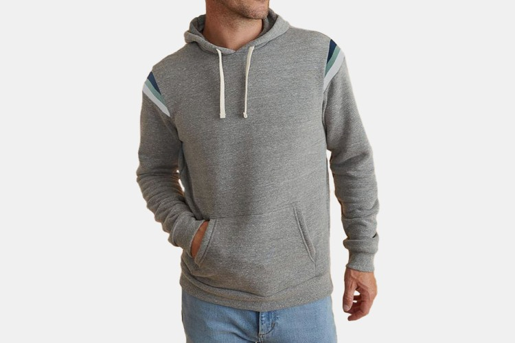 a grey hoodie on a model