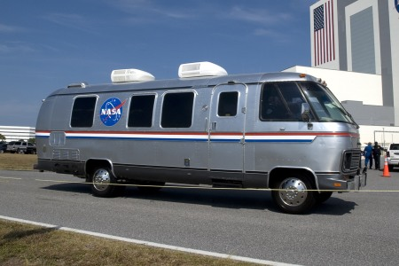 The NASA Astrovan, an Airstream motorhome outfitted to shuttle astronauts to the launch site, sitting still on a road