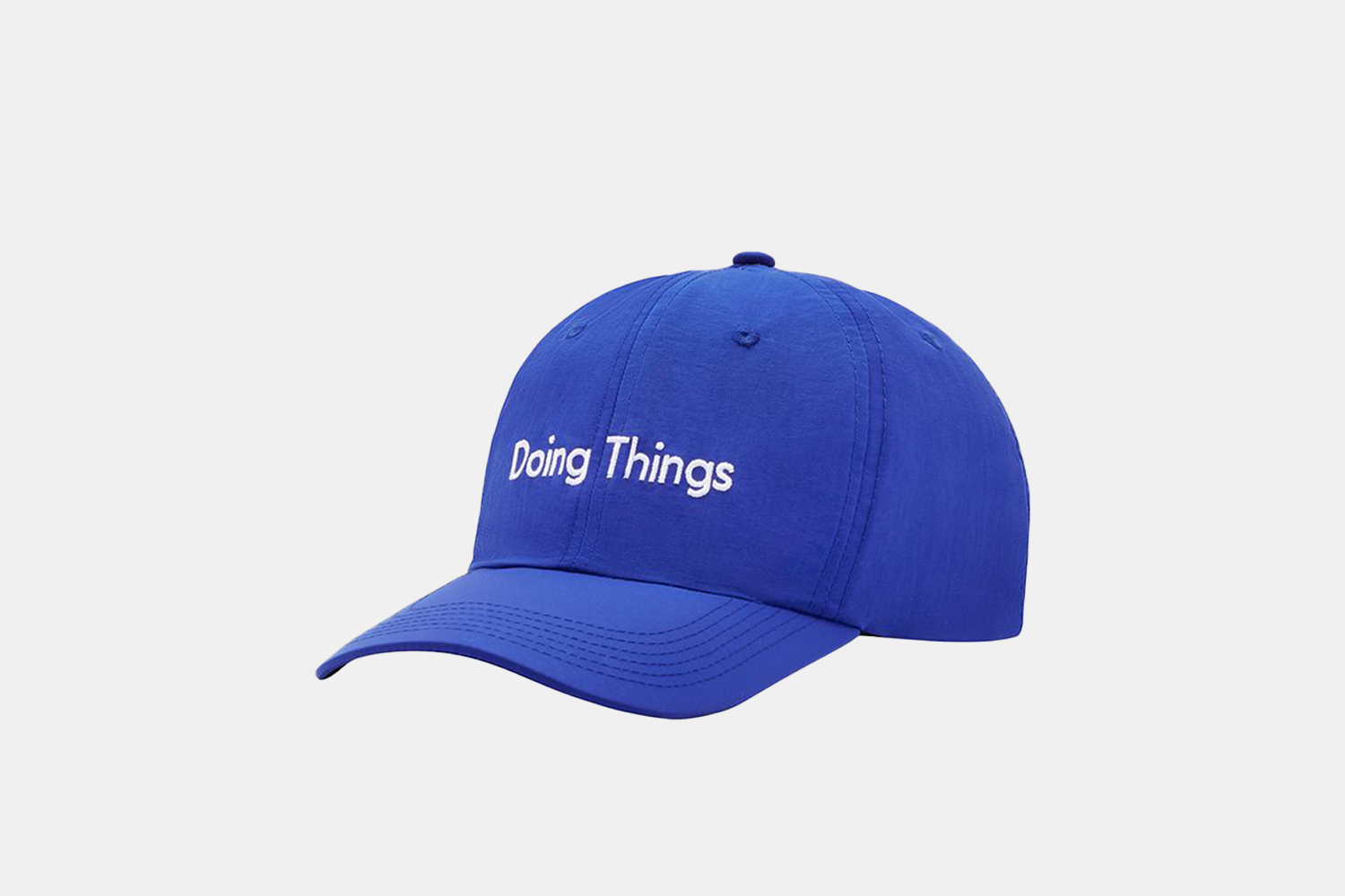 """a light blue hat with the phrase """"doing things"""" scrolled across the top."""
