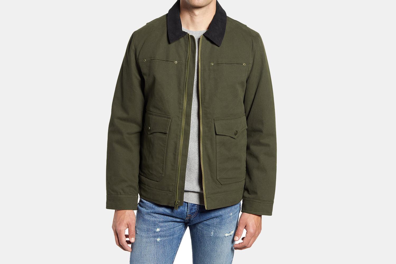 a dark green jacket wit h a black collat