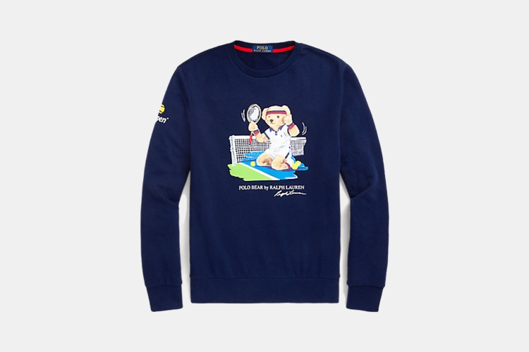 a blue crewneck fleece sweater with classic Polo Bear Iconography