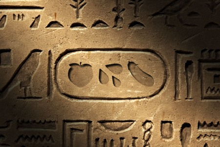 An Egyptian heiroglyph-style mural featuring raunchy emojis like the peach, eggplant and sweat droplets